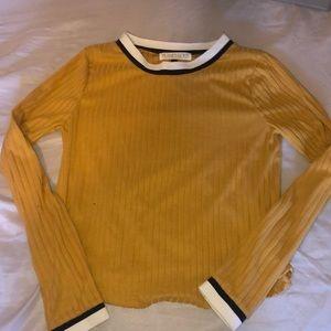 A yellow long sleeve